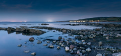 Watchet Coastline Night (PKpics1) Tags: watched england somerset westsomerset coast coastline sea seascape water sunset night rocks longexposure leadinglines lines sky