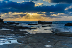 Sun Rays burst through the Clouds - Seascape (Merrillie) Tags: daybreak theskillion dawn nature australia terrigal rocky morning sea waterscape newsouthwales rocks earlymorning nsw coast landscape ocean sunrays cloudy sunrise coastal clouds outdoors seascape waves centralcoast water sky