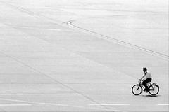 Biking for wings (R o m a n H) Tags: bw blackandwhite bicycle pilot airport airfield