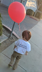 October 7: Holding the Balloon (earthdog) Tags: 2018 scooter googlepixel pixel androidapp moblog cameraphone sidewalk balloon walkingdistance sanjose project365 3652018