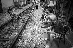 Living in the rails (Rui Palha) Tags: ruipalha hanoi street bw blackwhite streetphotography hánoi vietnam train trainstreet