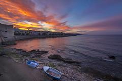 Sunrise in Alghero, Sardinia, Italy (diana_robinson) Tags: dramatic beach water boats sunrise alghero sardinia italy