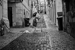 Lissabon Gente de Lisboa 28 bw (rainerneumann831) Tags: bw blackwhite street streetscene ©rainerneumann urban monochrome candid city streetphotography blackandwhite frau besen lisboa lissabon gentedelisboa