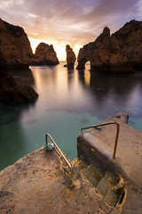Ponta da Piedade. (dasanes77) Tags: canoneos6d canonef1635mmf4lisusm tripod landscape seascape cloudscape clouds sea ocean stairs longexposure algarve lagos portugal pontadapiedade sunrise colors orange blue green rocks reflections shadows