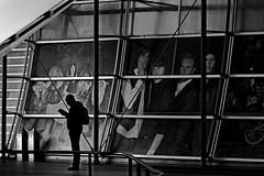 ......he checks  his mails...... (christikren) Tags: london linescurves location black christikren city o2 monochrome arena centre entertainment complex theo2 england silhouette man panasonic candid cinema