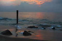 Twisted shadow (die Augen) Tags: canon sl2 ocean city beach sunrise waves sand sky shadow rocks light clouds