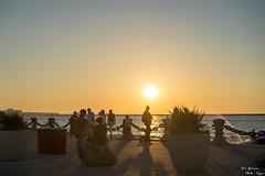 Lake Erie Sunset in Focus (yarnim) Tags: sunset lakeerie lake water ohio cleveland voinovichbicentennialpark rockandrollhalloffame a7m3 sel55f18z carlzeiss sony 55mm ilcea7m3 a7iii sonnar horizon sun sky skies beach people