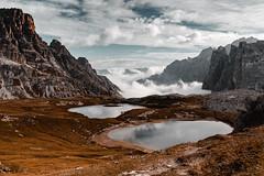 IMG_7404 (from_dusk_teal_dawn) Tags: mountains mountainrange dolomiten dolomites dolomiti lake lakes mountainlake cloudscape clouds cloudy fog peaks alpine südtirol trecime dreizinnen southtyrol