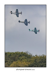 Unique formation - Mustang, Spitfire and Messerschmitt Bf109 flying over in formation (Roland Bogush) Tags: canoneos1dxmk2 canonef400mmf4doisusmmk2lensx2extender sywellcountryparknorthants bf109 luftwaffe usaaf raf mustangtp51d spitfiret9 twoseater