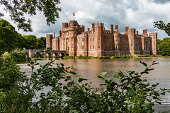 Herstmonceux Castle (Keith in Exeter) Tags: herstmonceux castle sussex building architecture moat lake water bridge fort turret tower flad sky tree landscape