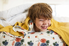 Yes! It's time for flannel sheets again! (Elizabeth Sallee Bauer) Tags: 7yearold active bed bedroom boy child childhood domesticlife family fun golden happiness indoors interior kid light playing portrait relaxing yellow