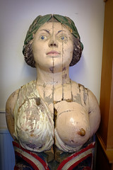 A figurehead is a carved wooden decoration found at the prow of ships, generally of a design related to the name or role of a ship. (Livesurfcams) Tags: breast nipple figurehead shipsprow wooden old antique patina widened blueeyes fuji fujifilm