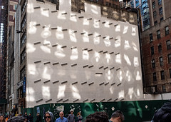 Window Reflections (UrbanphotoZ) Tags: constructionsite plywood fence green reflections glare windows wall girders brick redbrick pedestrians storefront fireescape pigeon posters lofts midtown manhattan newyorkcity newyork nyc ny