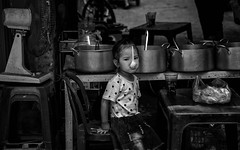 Hanoi Street (Rod Waddington) Tags: vietnam vietnamese hanoi streetphotography street stall food girl child culture cultural ethnic ethnicity pots spoon chairs fan glass people outdoor