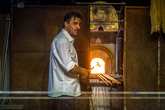 The artist on Murano demonstrating how he makes glass in Italy.