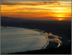 Sundown over Sandown (Jason 87030) Tags: glow warm fire sun set sunset down going beach sea clouds view sandown yaverland culverdown iow island isleofwight orange sky setting scene uk glowing waves sand