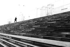Arriving at the top (pascalcolin1) Tags: paris13 bnf femme woman marches top haut photoderue streetview urbanarte noiretblanc blackandwhite photopascalcolin 50mm canon50mm canon