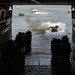 AAV-P7/A1 assault amphibious vehicles depart the well deck of the USS Ashland as part of a training exercise for KAMNDAG 2