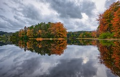 Autumn colours, Norway (Vest der ute) Tags: xt20 water waterscape reflections mirror autumn sky clouds trees haugesund eivindsvatnet fav25 fav200