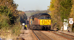 Colas Class 56 no 56090 brings up the rear into Worksop Coal Sidings on 18-10-2018 with the Stapleford to Toton RHTT via The World. (kevaruka) Tags: worksop station nottinghamshire sherwood forest october 18102018 autumn sun sunshine sunny day colour colours color colors class 20 56 66 choppers grid shed trains train rhtt freight network rail british yellow blue green composition locomotive heritage historic market town england canon eos 5d mk3 70200 f28 is mk2 5d3 5diii flickr thephotographyblog telephoto railway railfreight 20205 20007 railroad tree