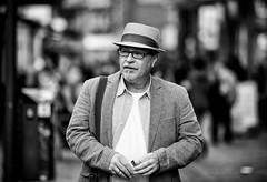 (graveur8x) Tags: man candid street potrait hat cigarette glasses dof blackandwhite bw bokeh wiesbaden germany deutschland streetphotography strase schwarzweis beard canon canonef135mmf2lusm canoneos5dmarkiv 135mm monochrome
