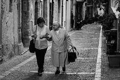 Villagers (Stefan Waldeck) Tags: women streetphotography street bw houses facades tiles cefalu italy 2018 netzki stefanwaldeck stefan waldeck