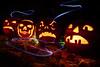 Happy Halloween (Christian Hacker) Tags: halloween pumpkin trickortreat longexposure autumn leaves fairylights candlelight candlelit skull monster evil grumpy dark spooky carving carvedpumpkin eery lightpainting canoneos50d tamron1750mm grimace monsters frightnight lighttrails