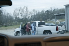 Allen Askew shakes the hand of a customer who ordered more than $600 worth of barbecue for his church group.
