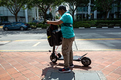 Food's going cold (jeremyhughes) Tags: singapore street deliveroo scooter delivery gigeconomy deliveryman lost city urban work working ricoh gr grd ricohgrdigital