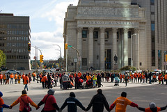 Portage & Main Round Dance 2018-09-30 — 6 (WPG Happening!) Tags: round dance rounddance portage main portageandmain portagemain pm 2018 residential school schools memorial ceremony residentialschools residentialschool canadianindianresidentialschools canadianindianresidentialschool indianresidentialschools indianresidentialschool indian indigenous native canadian nativecanadian american nativeamerican anishinaabe anicinabe people person group circle demonstration memorail commemoration protest winnipeg manitoba canada street road avenue st ave intersection traditional corner buildings building city exchange theexchange district exchangedistrict cityofwinnipeg orange shirt day shirts orangeshirtday