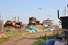 Not The Tourist Side Of Hastings (MedievalRocker) Tags: gravel boats hastings beachscene caterpillarbulldozers fishing baskets seagull rubbish