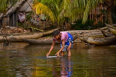 River Washing (Rod Waddington) Tags: madagascar malagasy river channel fishing village boats pirogue palm trees water woman washing outdoor people culture cultural ethnic ethnicity