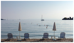 An Afternoon Swim (clive_metcalfe) Tags: corfu greece swimming yacht beach sunbed