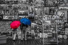 Krakow street art (Andy barclay) Tags: krakow cracow poland europe travel polish holiday tourist art street artist painting raining rain wet umbrella red blue black white bnw colour selective nikon d7100