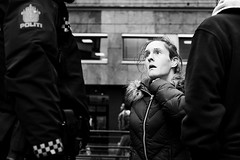 DSCF9455 (yann CM B) Tags: oslo norway police woman streetphotography blackandwhite blackwhitepassionaward blackdiamond fuji fujixt3 35mm 50mm candid people life