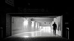 Thriller. (Guido Klumpe) Tags: thriller monochrome bnw schwarzweis schwarzweiss sw blackandwhite candid street streetphotography streetphotographer subway parking 24mm mann men kontrast contrast gegenlicht shadow schatten silhouette gebäude architecture architektur building perspektive perspective