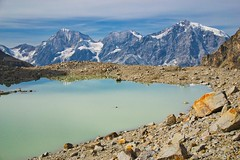 At a glacial lake on nearly 3000 meters height (echumachenco) Tags: panorama view moraine rubble stone landscape nikond3100 summer august sulden solda altoadige southtyrol südtirol ortles ortler granzebrù königspitze valley glacier snow ice rock cloud sky mountainside mountain alps gruppodell'ortles ortlergruppe valledizai zaytal glaciallake lake