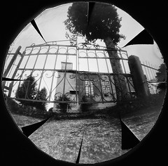 At the Gates (batuda) Tags: pinhole obscura stenope lochkamera analog analogue beer beercap lid round circular paper ilford ilfospeed d76 11 9950f building architecture church wooden interwar lowangle bw blackandwhite gates trees daunorių bažnyčia daunoriai tauragnai utena lithuania lietuva autumn september