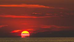 Almost Gone - A Lemnos Sunset  - Myrina Town - Limnos  (Olympus OM-D EM1-II & M.Zuiko 40-150mm f2.8 Telephoto Zoom) (1 of 1) (markdbaynham) Tags: greece greek limnos lemnos sunset seascape settingsun sun colour grecia greka hellenic hellas greekisland greekholiday greeceaegean aegean northaegean northaegeanisland sky travel greeksunset mft olympusmft olympus omd olympusomd olympusem1 m43 mzd mz zd zuikolic em1 em1ii em1mk2 csc mirrorless microfourthird microfourthirds olympusprolens prozoom zuikopro micro43 m43rd myrina mypina myrinatown landscape 40150mm f28 evil em1mark2