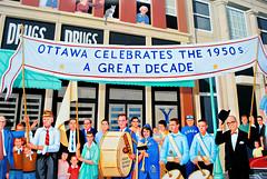 Ottawa, Illinois Celebrates the 1950's. (Cragin Spring) Tags: ottawa ottawail ottawaillinois illinois il midwest unitedstates usa unitedstatesofamerica mural people 1950s celebration window drugstore band drum 50s decade cat