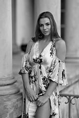 Kornelia (piotr_szymanek) Tags: kornelia korneliaw blackandwhite portrait outdoor woman young skinny longhair face eyesoncamera dress building park łazienki 1k 20f 50f 5k 100f 10k 20k 30k