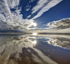 Sweet and Dandy (pauldunn52) Tags: beach wet sand reflection sunburst glamorgan heritage coast wales