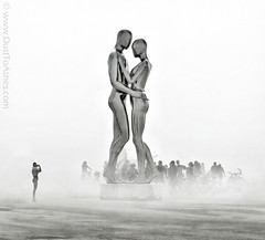 In Every Lifetime I Will Find You By Michael Benisty, Love and Unity; Burning Man (Dust To Ashes) Tags: burningmanfestival burningman2018 burningman irobot theme burning man bm2018 2018 dust ashes dusttoashes wwwdusttoashesnet sculpture sculptures installation installations surreal playa desert nevada gerlach nv blackrockcity brc art burningmanart desertparty photography photos photo pictures ales ineverylifetimeiwillfindyou michaelbenisty loveandunity sentientai metalicsculpture chromeartsculpture pollishedstainlessmetal manholdingwoman lovers duststorm