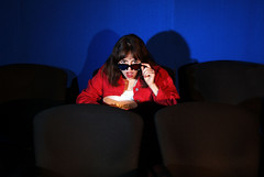 Surprised girl at the cinema (666abriela) Tags: girl brunette hispanic surprise cinema popcorn 3dglasses movie theater chairs seats red blue black white indoors wow amazing shadows