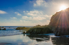 Sunset Sun Rays (SCSQ4) Tags: beach cliff clouds cloudy lagunabeach northcrescentbaybeach ocean reflections rocky shoreline sunrays sunburst sunset