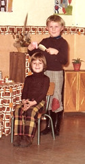 Hairdressing has to be done wearing wellingtons (theirhistory) Tags: boy children kid girl jumper trousers wellies shoes chair work play wellingtonboots