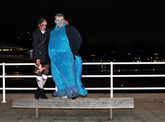 Leydis and Sully on bench by river (Martyn.Hayes) Tags: friends nightout fun drink booze alcohol london party halloween costume october31st 31october allhallowseve halloweenparty wednesdayadams sully zombie monstersinc river thames water bank bankside bench railings