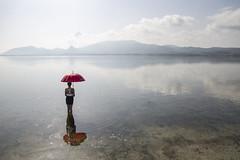 """Una """"mattina"""" allo stagno (nicolamarongiu) Tags: landscape paesaggio riflessi reflections acqua water montagna luce umbrella ombrello red rosso morning stagno marceddì sardinia sardegna"""