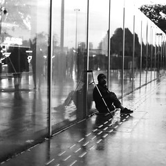 On the wrong side (pascalcolin1) Tags: paris homme man nuit night lumière light reflets reflection pluie rain vitres windows miroir mirrors photoderue streetview urbanarte noiretblanc blackandwhite 50mm canon50mm canon