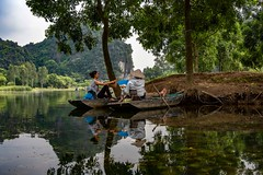 Riverside (Rod Waddington) Tags: vietnam vietnamese north river red trees sampan reflection water mountain women group landscape nature boats outdoor people culture cultural ethnic ethnicity